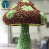 large green artificia grass mushroom topiary