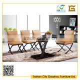 New design black tempered glass top metal base dining table sets with cross legs leather dining chair