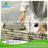 Masonry building material with dry mix mortar
