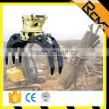 Excavator rotating grapple for wood