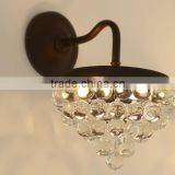 0108-13 CRYSTAL Clear glass droplets sparkle in the light cast by this bronze-finished sconce