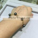 wholesale 6-6.5mm black round tahitian pearl bracelet