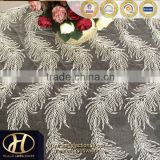 CORDED LACE EMBROIDERY FABRIC ON WHITE MESH FACTORY