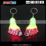 Wholesale promotion item foot shape flashing led keychain