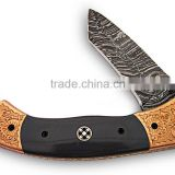 A HANDMADE ENGRAVED RED COPPERBOLSTERS WITH BUFFALO HORN HANDLE, DAMASCUS STEEL LINER LOCK FOLDING KNIFE
