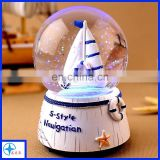 resin sailing ship snow globe