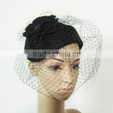 Felt fascinator hat with veiling