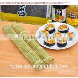 Sushi roll, consisting of cutting board, bamboo mat, sushi knife, chopsticks Bamboo Sushi roll