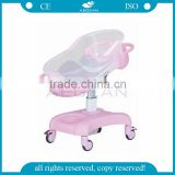 pink color AG-CB011 CE ISO movable hospital plastic baby crib medical infant cot