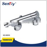 Single lever wall mounted thermostatic bath shower mixer tap