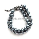 Fashionable women jewelry gun black handmade glass based fancy pearl bracelet