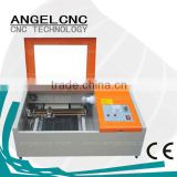 Top quality CO2 laser cutting machine for acrylic/cloth/fabric/wood/leather laser cutting