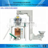 High Quality with Competitve Price Automatic Weighing Vertical Food Nut Dried Fruit Packaging Machines from Foshan China
