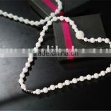 White cowry shell necklace