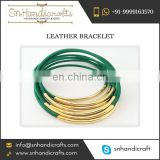 Bangle Shaped Green and Golden Colour Thin Leather Bracelet Available for Bulk Buying