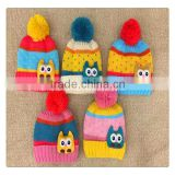 hot sale striated colorful winter knitted hat with owl decoration for kids ,with ball top