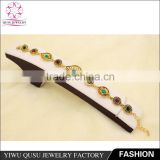 2015 Yiwu new products antique gold plated bracelet with rhinestone and emerald water drop imitation jade