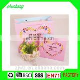 2015 cost production cookies packing paper bag with hanlde for shopping