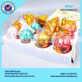 New design cheap colorful yellow red pink green orange cracked growth dinosaur egg for child education