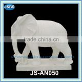 carved outdoor white elephant statues