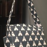 Grey and white messenger style diaper bag with good quality