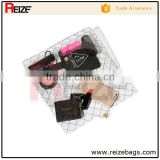 Alibaba latest fashion clear pvc plastic bag with snap button hangbag