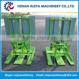 Hand held paddy transplanter/rice planting machine