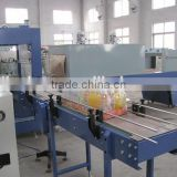Automatic hot shrink film wrapping packing machine