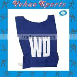 Multicolor netball bibs with sublimated numbers