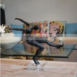 Interesting shape of kick ball sculpture in black                                                                         Quality Choice