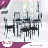 Wholesale modern design dining room table set 9mm thick cheap black glass top dining table 6 chairs set
