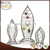 Fish design metal wine bottle display rack