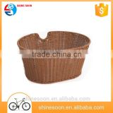 Brown bicycle front woven plastic storage basket