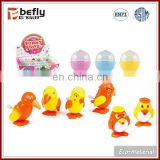 Small plastic bird wind up mechanism toy