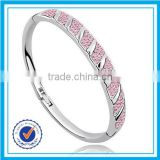 Zinc alloy plated silver pink crystal jamaican bangle