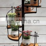 The bird eight stairs iron flowerpot shelf Wrought iron pergola