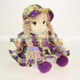 Rural style sitting Straw doll clothed in a flowered dress