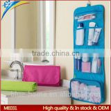 Trip portable folding canvas cosmetic bag into pouch with trqansparent mesh inside Hanging in washroom hotel