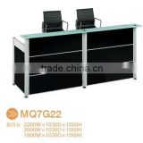 Black tufted reception desk made with tempered glass