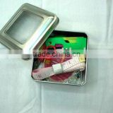 mini home sewing kit in a metal box