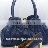 Fashion young lady shoe and handbag