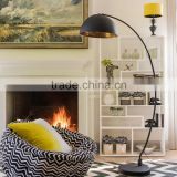 0403-1 A real statement With bold curves and a distressed inner golden shade The Arc Black Metal Floor Lamp