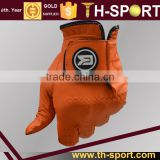 Orange Cabretta synthetic leather driving golf glove with ball marker
