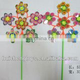 Six plastic fanny faces and flowres pinwheel HC101391