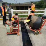 Asphalt plug expansion joint for bridge and highway road