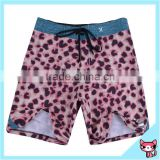 Pink leopard pattern board shorts for men