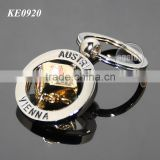 Gold Cube Shaped Customized Austria Souvenir Promotional Silver Rotating Metal Vienna Keychain