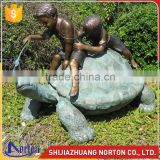Playing on a turtle bronze boy and girl garden statue NTBH-C1039A