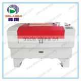 Shandong Jinan latest laser machine model laser engraving cutting machine/mini craft laser engraving machine 6090 with CE