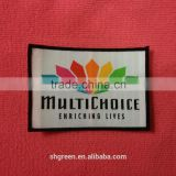 colorful textile woven badge with merrow border